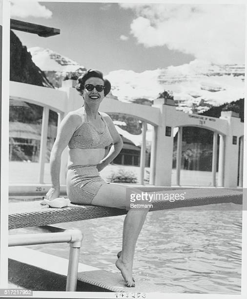 Vacationing in Canada Lake Louise Canada Movie actress Joan Crawford prepares for a dip in the swimming pool at the Chateau Lake Louise in the...