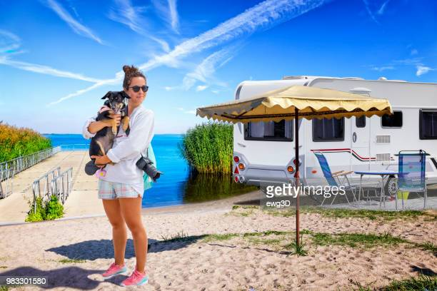 vacations in germany - young woman on the beach on the shore of the szczecin lagoon - camper trailer stock pictures, royalty-free photos & images