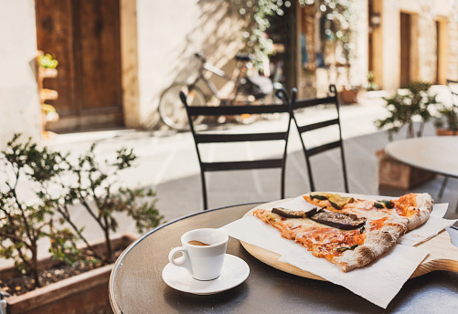 Vacations in Italy. Pizza and coffee in italian cafe 1088931130