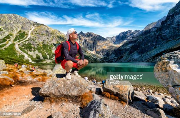 vacations in poland - middle-aged tourist on a trip to the tatra mountains - zakopane stock pictures, royalty-free photos & images
