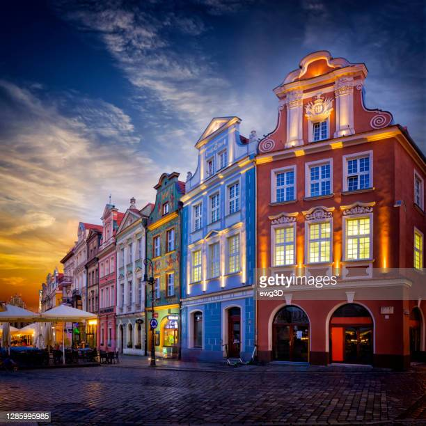 vacations in poland - old town square in poznan by sunset - old town stock pictures, royalty-free photos & images
