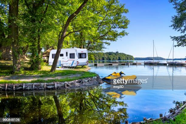 vacations in poland - summer view on a bay of the drawsko lake - jet ski stock pictures, royalty-free photos & images