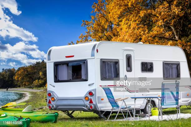 vacations with a camper by the lake in masuria region, poland - camper trailer stock pictures, royalty-free photos & images