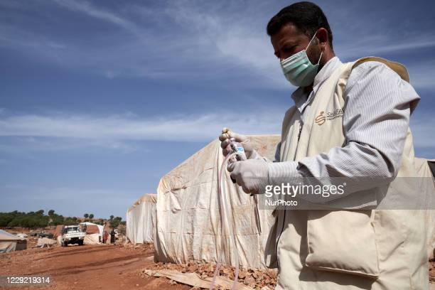 Vaccinating sheep against Foot-and-mouth disease in refugee camps near Idlib province, Syria on October 20, 2020