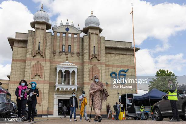 Vaccination centre and mobile PCR testing van is set up outside the Shri Guru Singh Sabha, a Sikh temple, on May 27, 2021 in Hounslow, England. The...