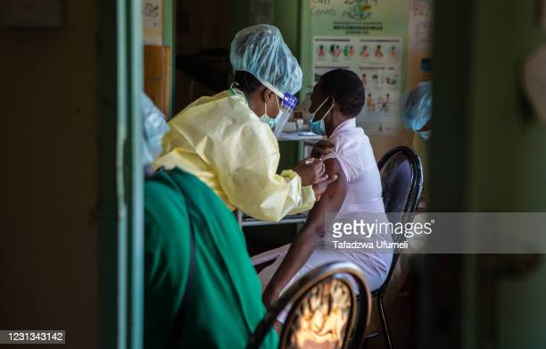 Vaccination team health worker administers the Sinopharm vaccine to a nurse at Jari Village Clinic in Zvimba Rural District on February 23, 2021 near...
