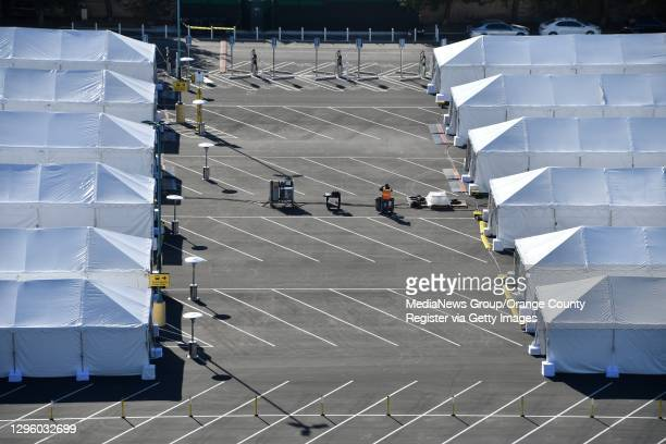 Vaccination tents are set up in the north of the Toy Story parking lot at the Disneyland Resort on Tuesday, Jan. 12 in Anaheim, CA. The parking lot...