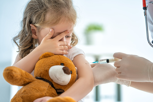 vaccination to a child 1057582308