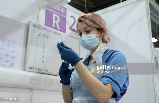 Vaccinator Nicole Clark prepares a Covid-19 vaccination at the NHS Louisa Jordan Hospital on February 10, 2021 in Glasgow, Scotland. More than one...
