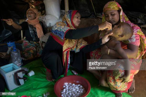 Vaccinators give the oral cholera vaccine to Rohingya October 11 in Thainkhali refugee camp Cox's Bazar Bangladesh A massive cholera immunization...