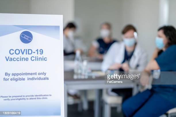 covid-19 vaccine clinic information poster for healthcare workers - vaccination center stock pictures, royalty-free photos & images