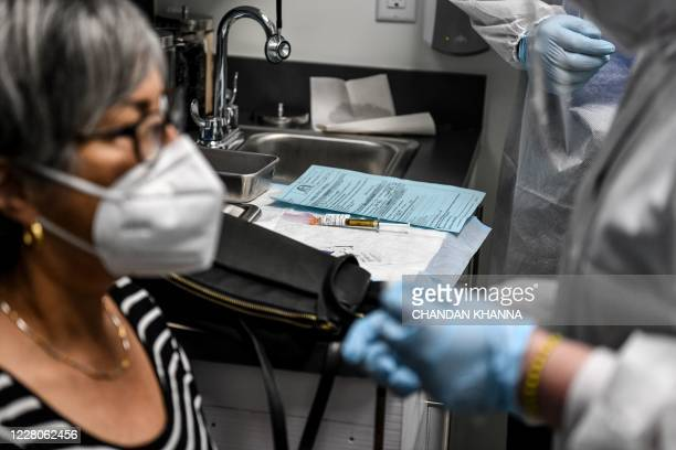 Vaccine is ready to be given to a volunteer at the Research Centers of America in Hollywood, Florida, on August 13, 2020. - So-called phase three...