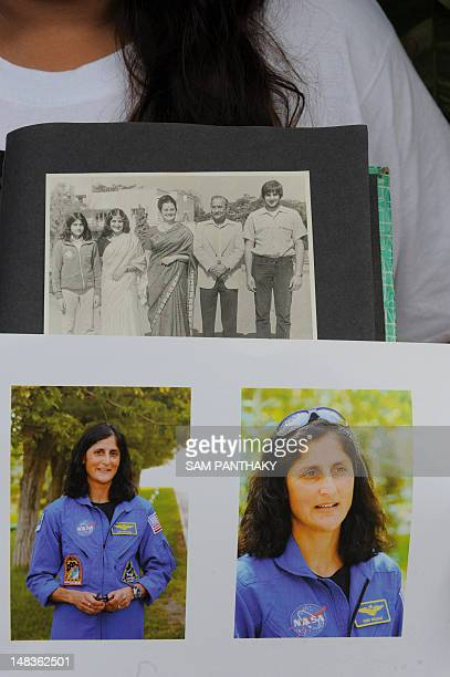 Vacha Pandya niece of US astronaut of IndianSlovenian origin Sunita Williams holds a family photograph taken in 1976 and recent portraits of Williams...