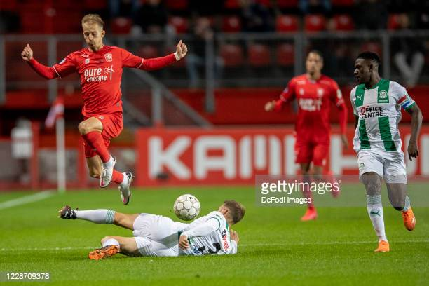 Vaclav Cerny of Fc Twente, Bart van Hintum of FC Groningen and Azor Matusiwa of FC Groningen Battle for the ball during the Dutch Eredivisie match...