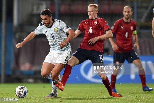 Vaclav Jemelka of Czech Republic in action against John McGinn of Scotland during the UEFA Nations League soccer match between Czech Republic and...