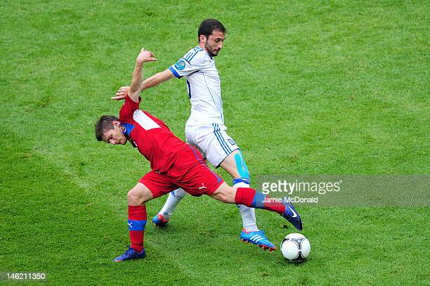 Vaclav Pilar of Czech Republic and Giorgos Fotakis of Greece fight for the ball during the UEFA EURO 2012 group A match between Greece and Czech...