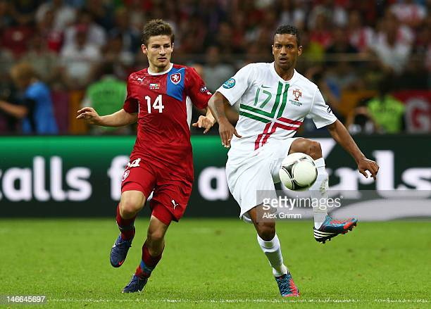 Vaclav Pilar of Czech Republic and Nani of Portugal battle for the ball during the UEFA EURO 2012 quarter final match between Czech Republic and...