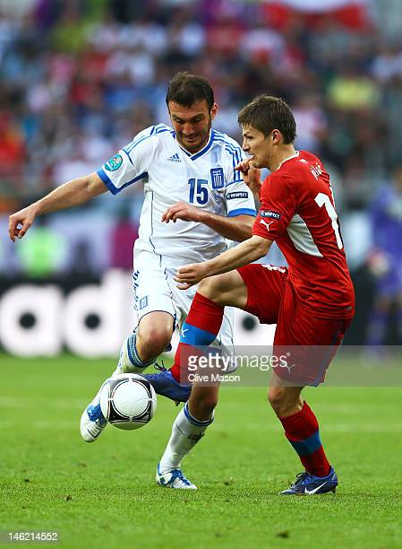 Vaclav Pilar of Czech Republic and Vasilis Torosidis of Greece compete for the ball during the UEFA EURO 2012 group A match between Greece and Czech...