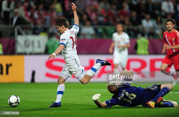 Vaclav Pilar of Czech Republic goes past goalkeeper Vyacheslav Malafeev of Russia to score their first goal during the UEFA EURO 2012 group A match...