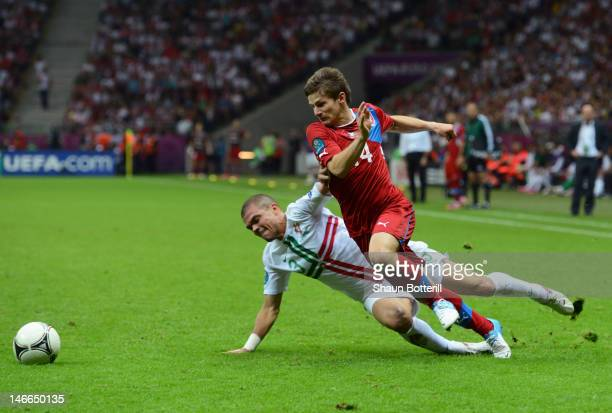 Vaclav Pilar of Czech Republic goes past the challenge from Pepe of Portugal during the UEFA EURO 2012 quarter final match between Czech Republic and...