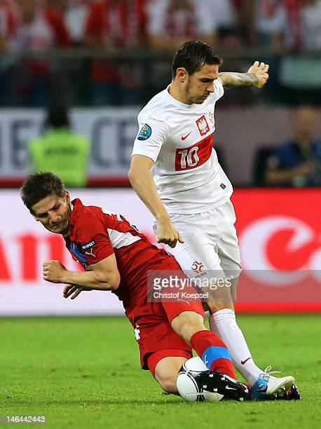 Vaclav Pilar of Czech Republic tackles Ludovic Obraniak of Poland during the UEFA EURO 2012 group A match between Czech Republic and Poland at The...