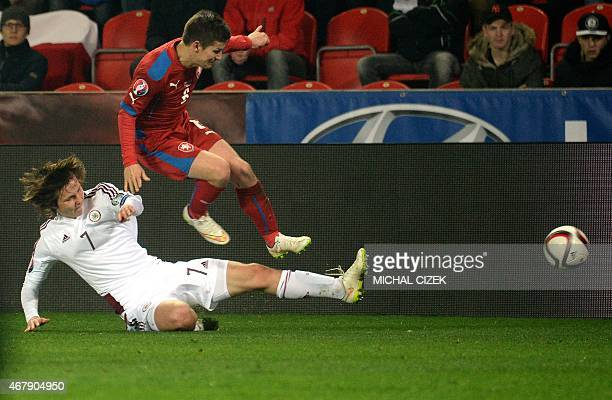 Vaclav Pilar of Czech Republic vies with Janis Ikaunieks of Latvia during the Group A Euro 2016 qualifying football match between Czech Republic and...