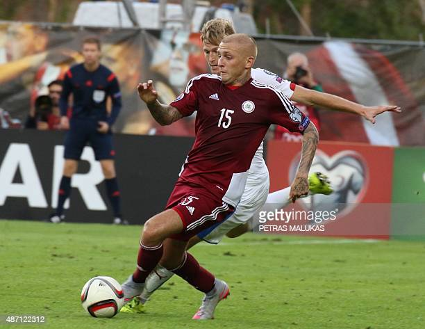 Vaclav Prochazka of Czech Republic vies with Latvia's Deniss Rakels during the Euro 2016 qualifying football match between Latvia and Czech Republic...