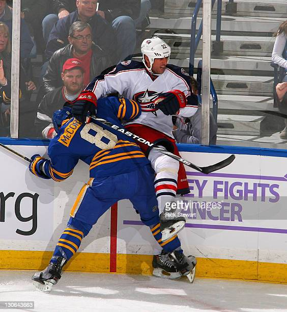 Vaclav Prospal of the Columbus Blue Jackets is checked by Cody McCormick of the Buffalo Sabres at First Niagara Center on October 27 2011 in Buffalo...