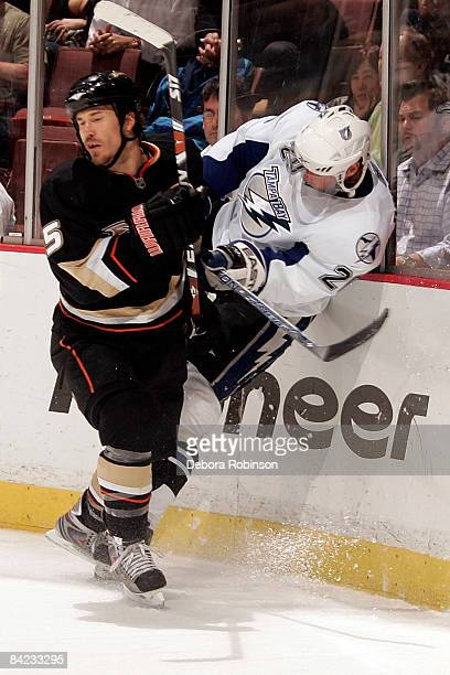 Vaclav Prospal of the Tampa Bay Lighting is checked into the boards Steve Montador of the Anaheim Ducks during the game on January 9 2009 at Honda...