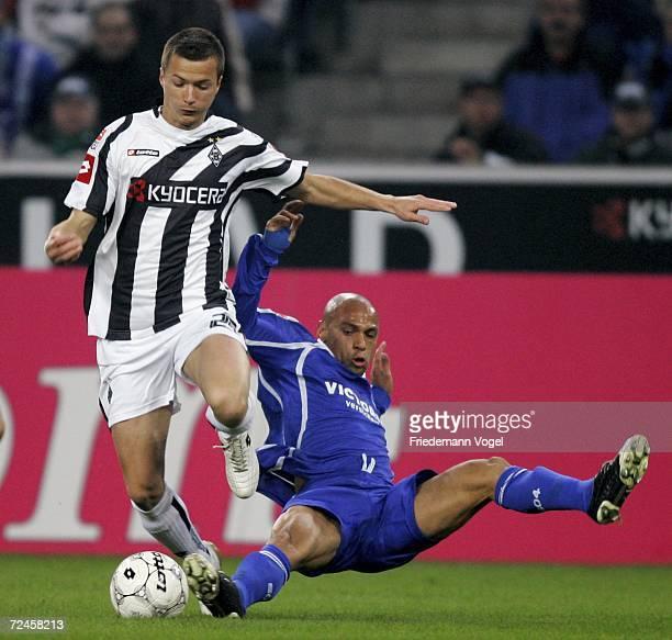 Vaclav Sverkos of Gladbach tussles for the ball with Gustavo Varela of Schalke during the Bundesliga match between Borussia Monchengladbach and...