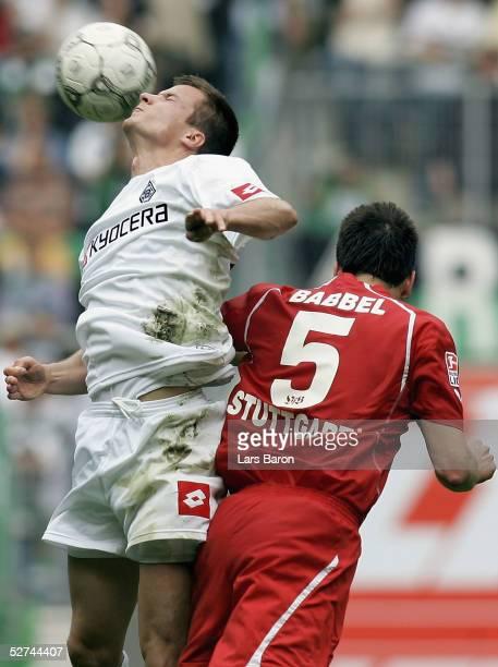 Vaclav Sverkos of Monchengladbach goes up for a header with Markus Babbel of Stuttgart during the Bundesliga match between Borussia Monchengladbach...