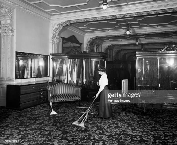 Vacuum cleaner demonstration Frederick Gorringe's Department Store 75 Buckingham Palace Road London 1910 A woman demonstrating the latest in vacuum...