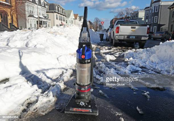 A vacuum cleaner serves as a 'space saver' for a parking spot on East Fourth Street in South Boston on Jan 9 2018 Boston has enforced a 48hour rule...