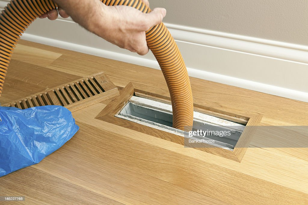 Vacuum Hose Cleaning Floor Vent and Duct : Stock Photo
