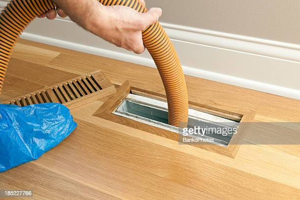 Vacuum Hose Cleaning Floor Vent and Duct