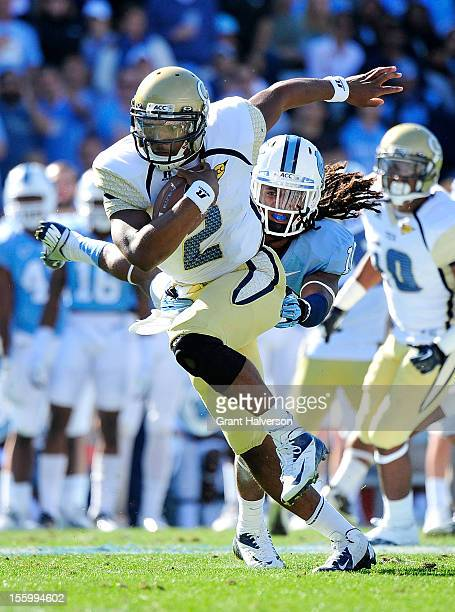 Vad Lee of the Georgia Tech Yellow Jackets breaks away from Tre Boston of the North Carolina Tar Heels during play at Kenan Stadium on November 10...