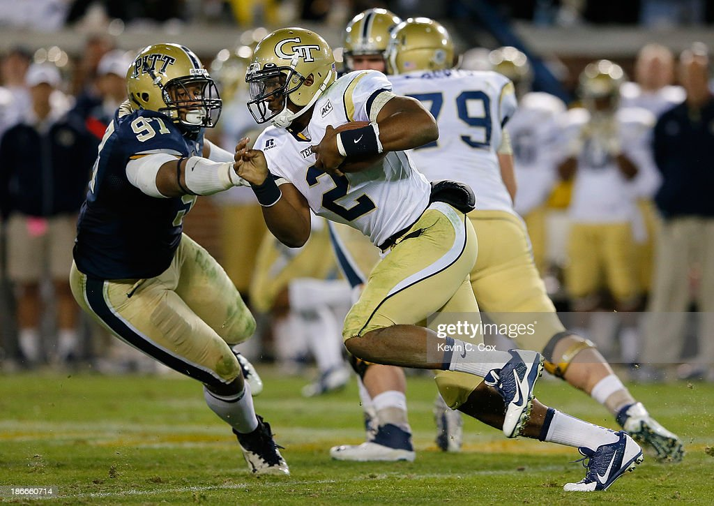 Vad Lee #2 of the Georgia Tech Yellow Jackets rushes past Aaron Donald #97 of the Pittsburgh Panthers at Bobby Dodd Stadium on November 2, 2013 in Atlanta, Georgia.