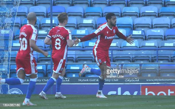 Vadaine Oliver of Gillingham FC celebrates scoring a goal during the Sky Bet League One match between Portsmouth and Gillingham at Fratton Park on...