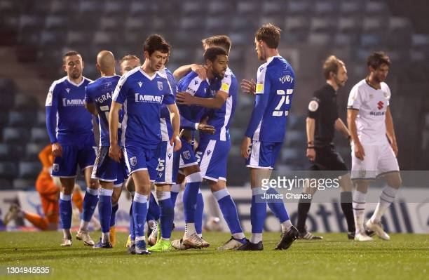 Vadaine Oliver of Gillingham FC celebrates with Jack Tucker and Robbie Cundy after scoring his sides second goal during the Sky Bet League One match...