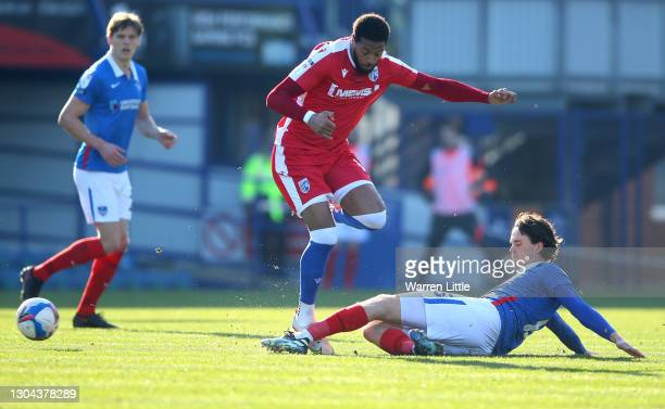 Vadaine Oliver of Gillingham FC is tackled by Rasmus Nicolaisen of Portsmouth FC during the Sky Bet League One match between Portsmouth and...