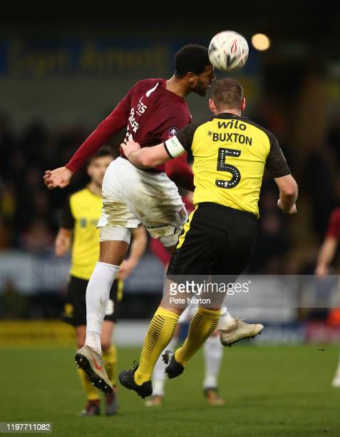 Vadaine Oliver of Northampton Town contests the ball with Jake Buxton of Burton Albion during the FA Cup Third Round match between Burton Albion and...