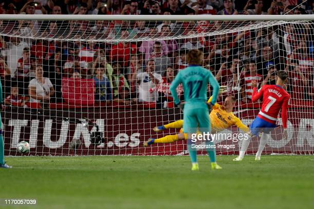 Vadillo of Granada CF scores the second goal to make it 20 during the La Liga Santander match between Granada v FC Barcelona at the Nuevo Estadio de...