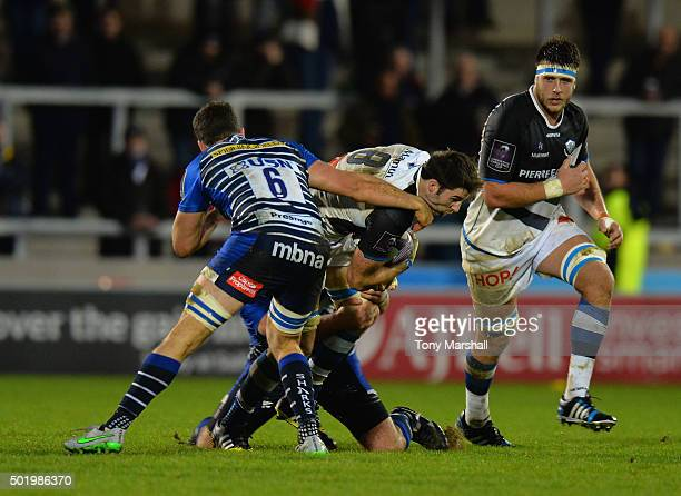 Vadim Cobilas and Mark Easter of Sale Sharks tackles Johnnie Beattie of Castres Olympique during the European Rugby Challenge Cup match between Sale...