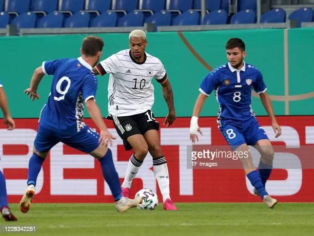 Vadim Gulceac of Moldavia, Lukas Nmecha of Germany, Alexandr Belousov of Moldavia during the UEFA Euro Under 21 Qualifier match between Germany U21...