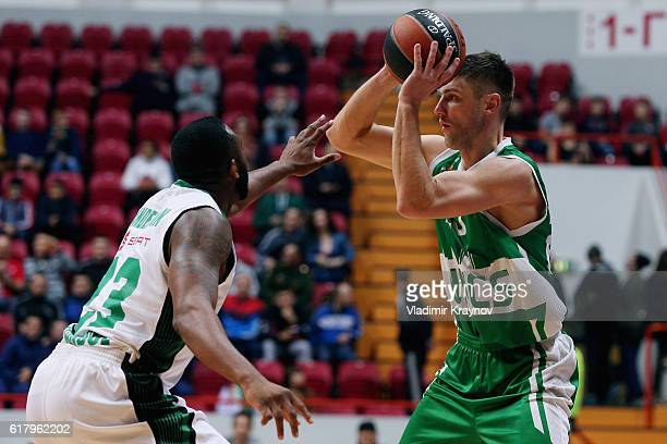 Vadim Panin #20 of Unics Kazan competes with James Anderson #23 of Darussafaka Dogus Istanbul in action during the 2016/2017 Turkish Airlines...