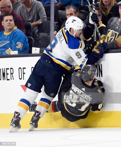 Vadim Shipachyov of the Vegas Golden Knights is checked by Scottie Upshall of the St Louis Blues at TMobile Arena on October 21 2017 in Las Vegas...