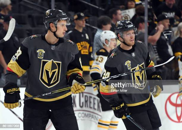 Vadim Shipachyov of the Vegas Golden Knights picks up a puck with his stick during warmups before the team's game against the Boston Bruins at...