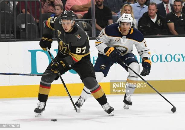 Vadim Shipachyov of the Vegas Golden Knights skates with the puck ahead of Jordan Nolan of the Buffalo Sabres in the second period of their game at...