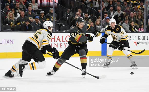 Vadim Shipachyov of the Vegas Golden Knights skates with the puck between Brandon Carlo and Matt Beleskey of the Boston Bruins in the second period...