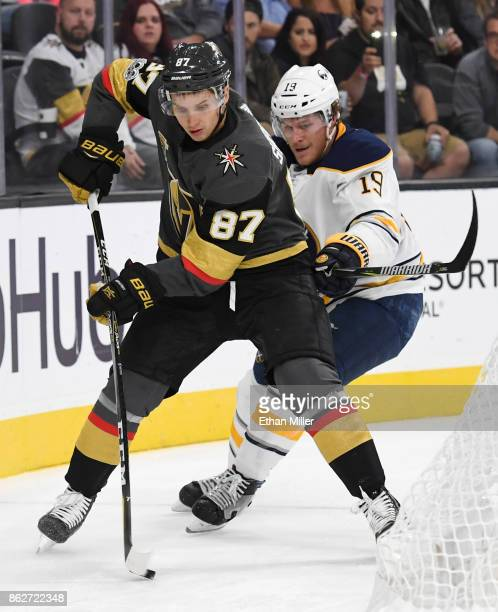 Vadim Shipachyov of the Vegas Golden Knights skates with the puck behind the net against Jake McCabe of the Buffalo Sabres in the second period of...